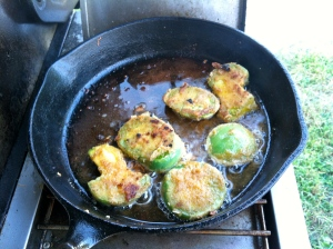 Frying green tomatoes in bacon grease.