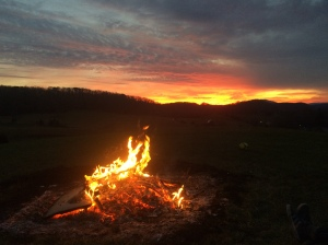 Fire and setting sun